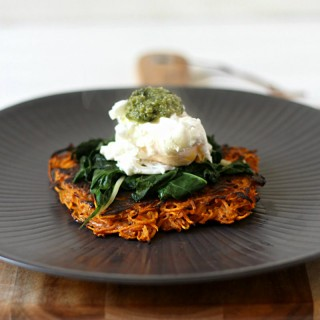 Delicious sweet potato fritters topped with garlicky greens, a poached egg and pesto